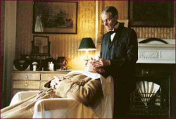 Sir John getting a shave from Edgar, the butler