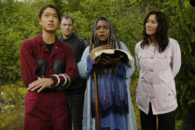 Sharon, Helo, Priestess Elosha, and President Roslin read scripture on Kobol